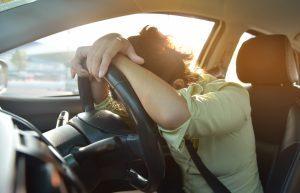 Woman in car having a stroke