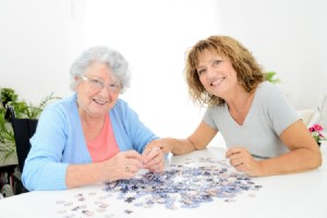 Older woman and mid aged woman doiung puzzle